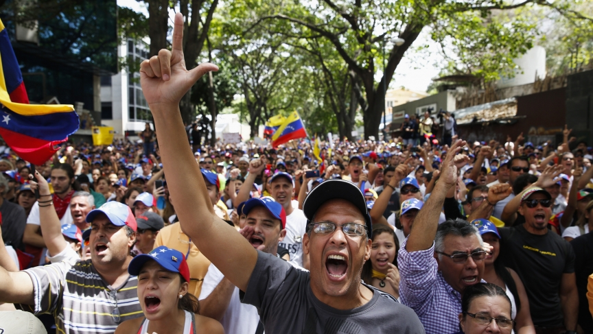 Anti-government protesters shout during a protest against Nicolas Maduro's government in Caracas March 3, 2014.