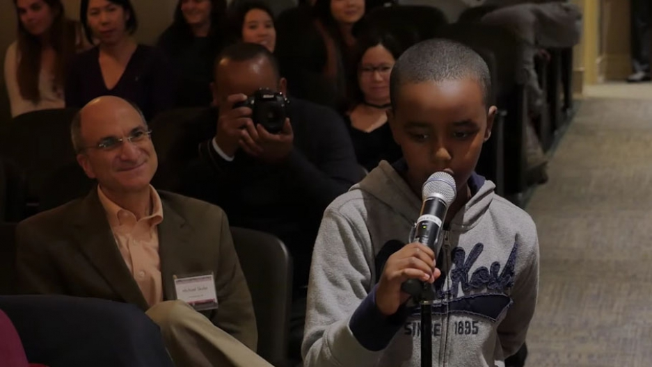 A boy asks a question during PRI's forum on the refugee crisis at Macalester College on Oct. 29.