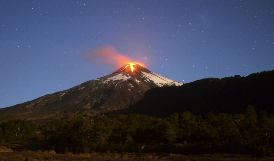 Ash and lava spew from the Villarrica volcano, as seen from Pucon town in the south of Santiago.