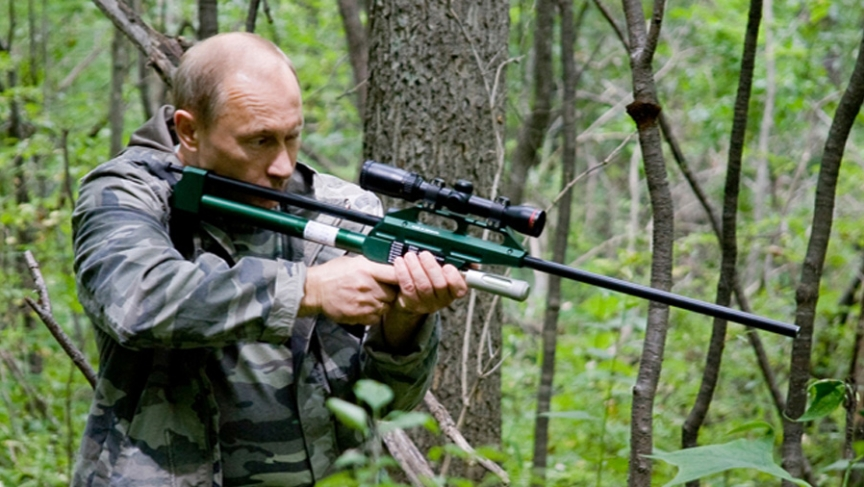 Vladimir Putin uses a tranquilizer gun to sedate an Amur Tiger during his visit to a nature reserve in eastern Russia.