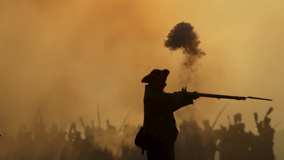 A history enthusiast, dressed as a soldier, fights during the re-enactment of Napoleon's famous battle of Austerlitz.