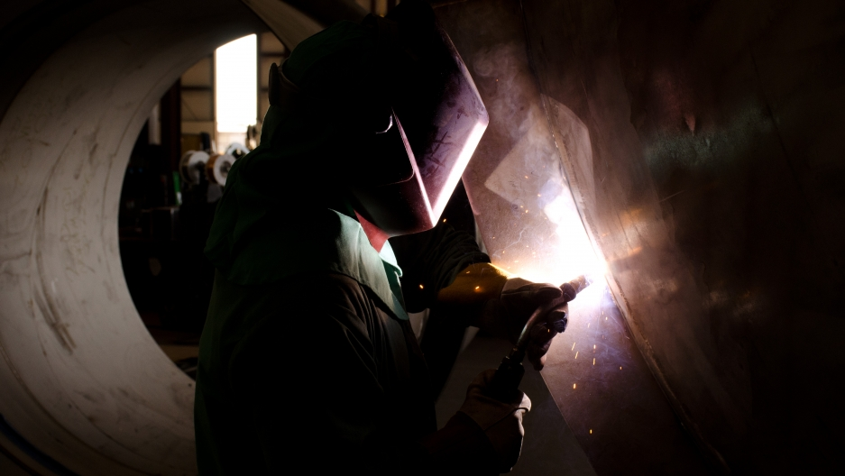 A welder at Caid Industries. Business has slowed this year at the Tucson, AZ company with uncertainty surrounding the future of NAFTA.