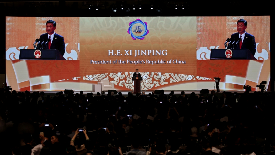 China's President Xi Jinping speaks on the final day of the APEC CEO Summit in Danang, Vietnam, Nov. 10, 2017.