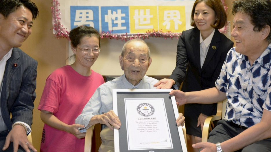 Japanese Yasutaro Koide, 112, receives the Guinness World Records certificate as he is formally recognized as the world's oldest man. He lives in a nursing home in Nagoya, in central Japan.