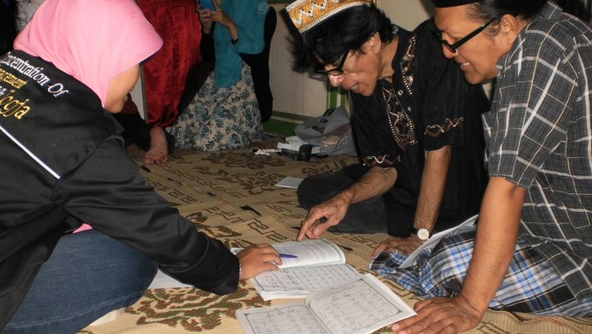 Transgender women study during an Arabic class at the Pondok Pesantren Waria Islamic school in Indonesia. Bunda Yeti, wearing a plaid shirt (at right), says the school has given her a place to practice her faith free of worry.