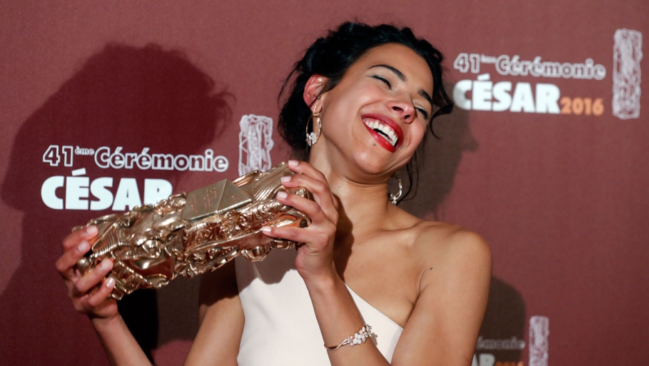"""Actress Zita Hanrot holds her trophy after receiving the Best Female Newcomer Award for her role in the film """"Fatima"""" at the 41st Cesar Awards ceremony in Paris, France."""