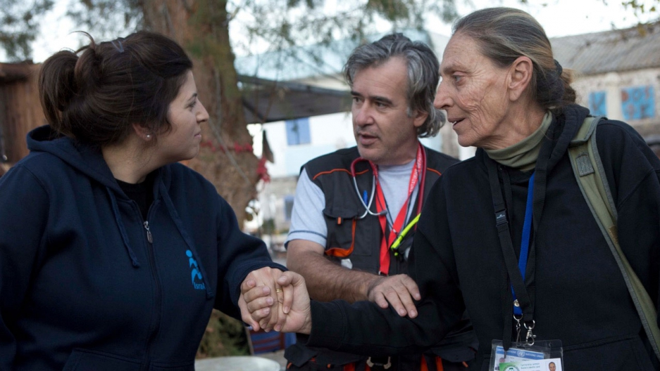 Dr. Zoi Livaditou (R) greets Dr. Shimrit Eliyah of Israid in Skala Sykaminia, Lesbos, Greece. Dr. Andreas Iliadis looks on.