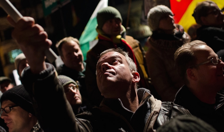 A man waves a German flag during a PEGIDA demonstration last month in Dresden, Germany.