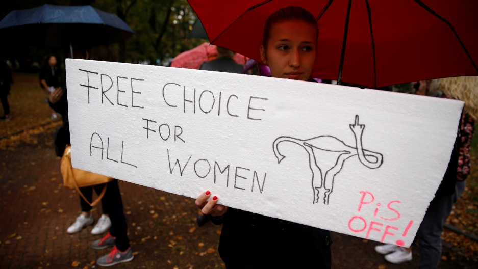 A woman holds a placard in an abortion rights campaigners' demonstration