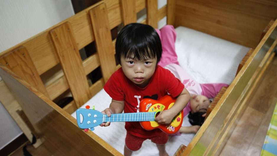 """Lee Jin-ri had been abandoned at a """"baby box"""" at South Korean church. The """"baby box"""" is where mothers can leave unwanted infants.  South Korea was the first country to send its babies abroad for adoption."""