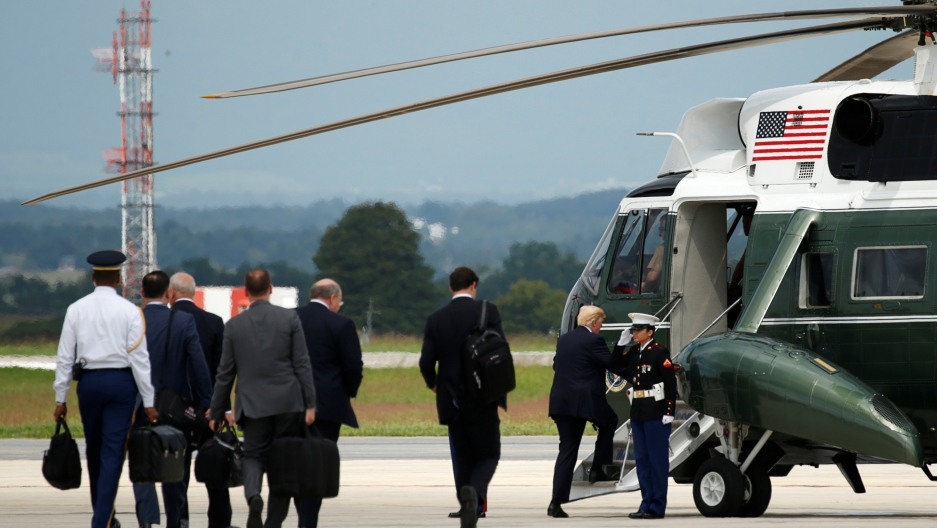 President Donald Trump and members of his staff board Marine One