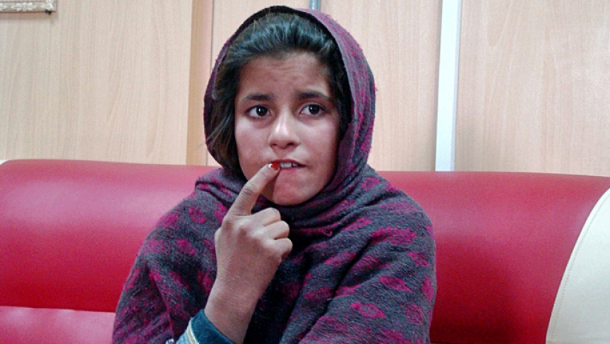 An Afghan girl named Spozhmai is held in a border police station in the southeastern part of Helmand province, Afghanistan.