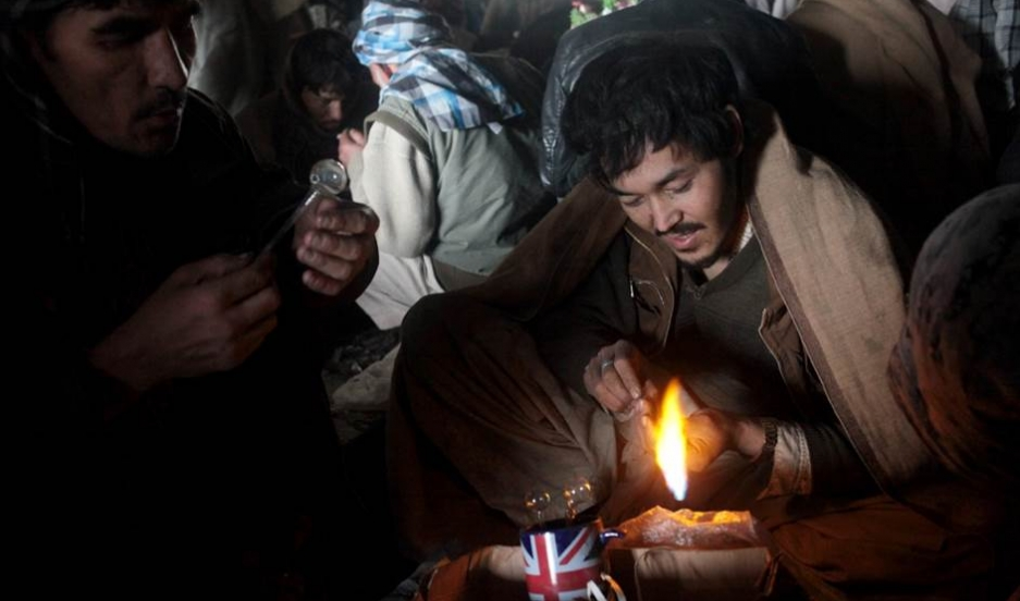 Three addicts preparing to smoke heroin under a bridge in Kabul's Pol-e Sokhta neighborhood.