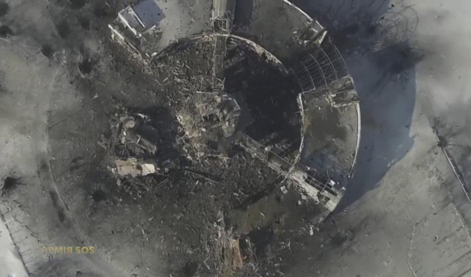 An aerial photograph taken by a drone shows the air traffic control tower of the Sergey Prokofiev International Airport damaged by shelling during fighting between pro-Russian separatists and Ukrainian government forces in eastern Ukraine.
