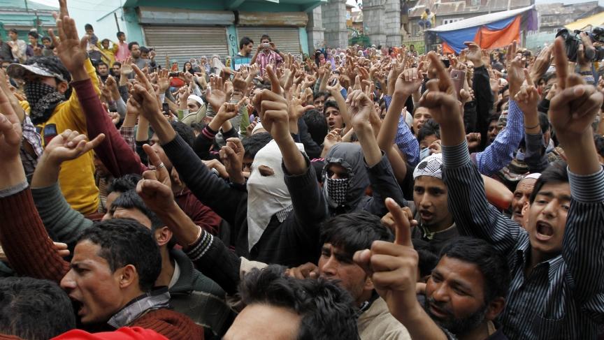 Kashmiri men shout slogans praising Osama Bin Laden after funeral prayers for him in Srinagar May 6, 2011.