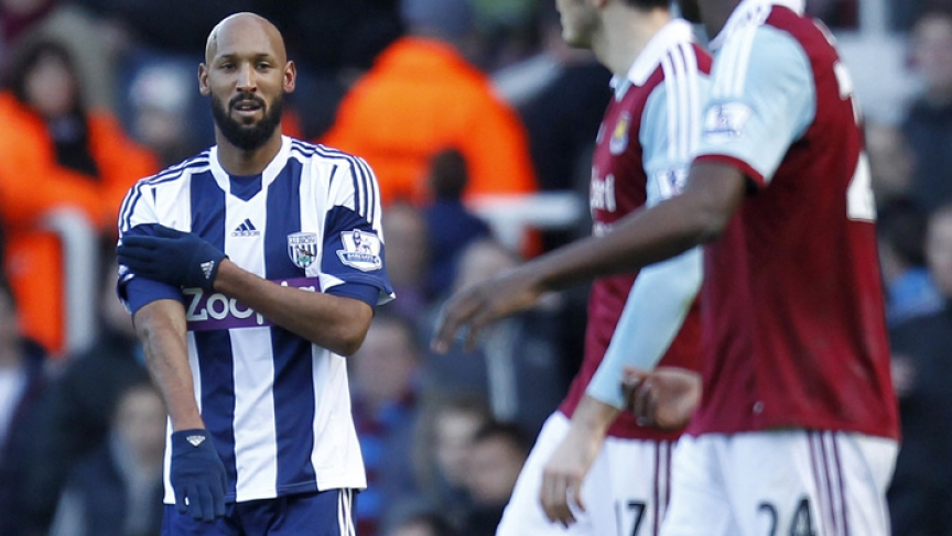 West Bromwich Albion's French striker Nicolas Anelka gestures as he celebrates scoring their second goal during the English Premier League football match.