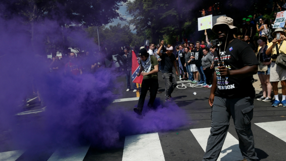 A smoke bomb is thrown at a group of counter-protesters during a clash against members of white nationalist protesters in Charlottesville, Virginia, U.S., August 12, 2017.