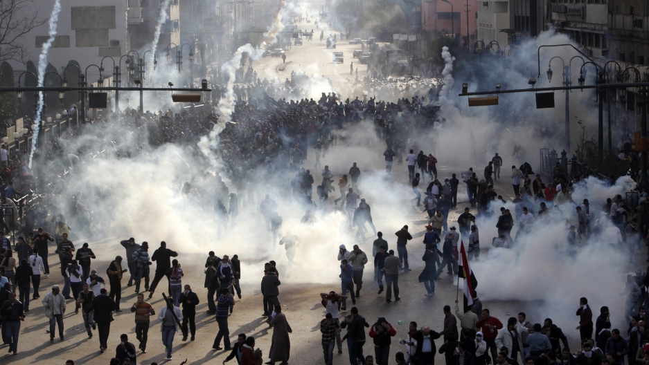 Protesters flee from tear gas
