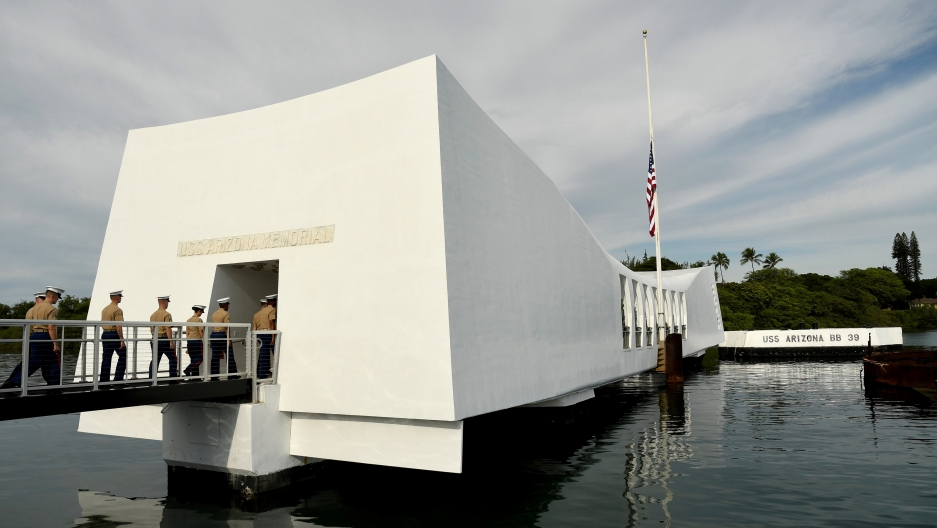 US Marines walk onto the USS Arizona memorial