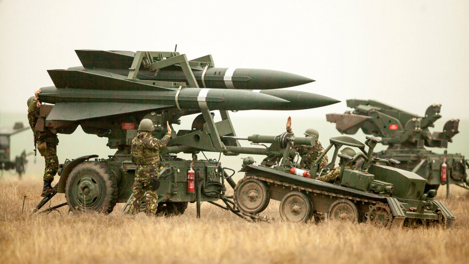 Romanian Army soldiers deploy a ground-to-air missile launch pad during a joint military exercise with the US Army.