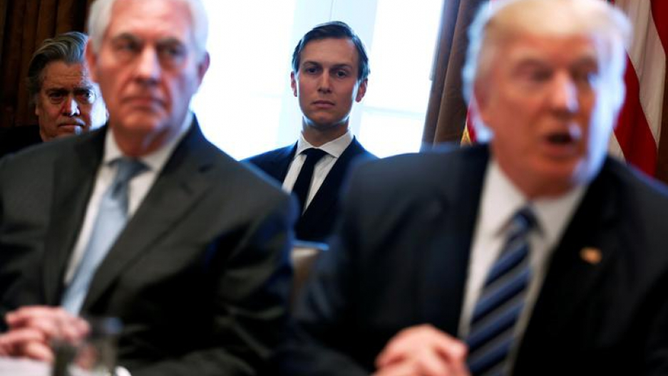 Secretary of State Rex Tillerson and President Donald Trump appear in a blurry photograph during a cabinet meeting. White House advisors Steve Bannon and Jared Kushner look on in the background.