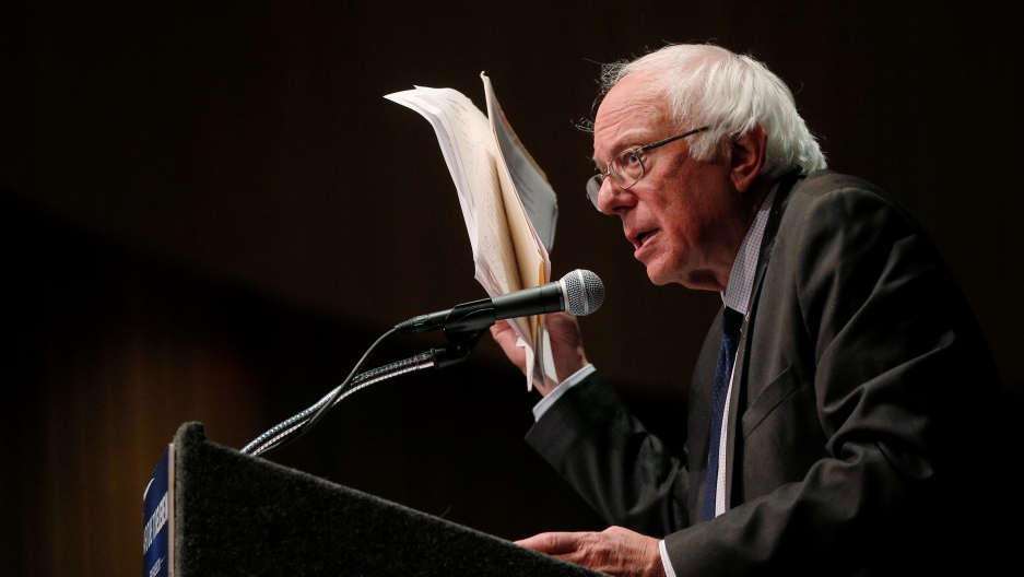 Bernie Sanders holds up his notes