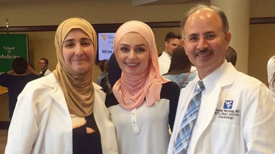 Dr. Chalak Berzingi poses with his wife, Dr. Mayada Issa, and his daughter, Seher Berzingi.
