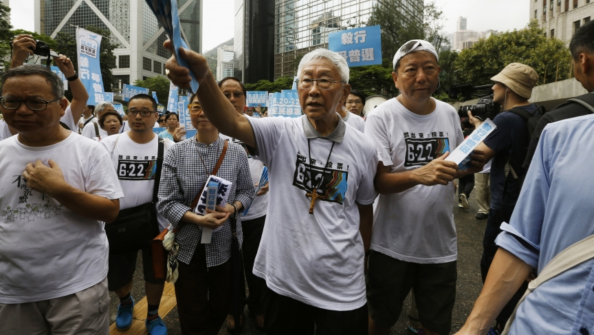 The 82 year-old Cardinal Joseph Zen (center) is the former head of the Roman Catholic Church in Hong Kong and a supporter of the student-led pro-democracy campaign in the Chinese territory.