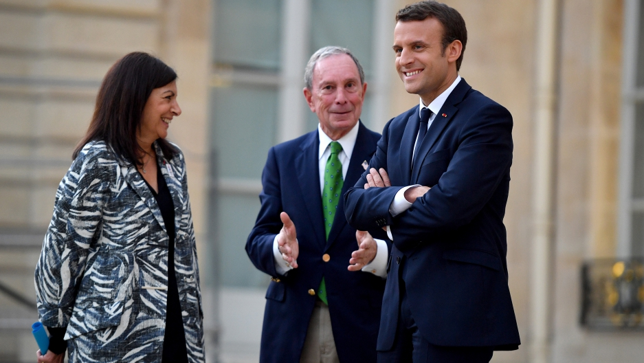 French President Emmanuel Macron, right, Paris Mayor Anne Hidalgo and former mayor of New York City Michael Bloomberg