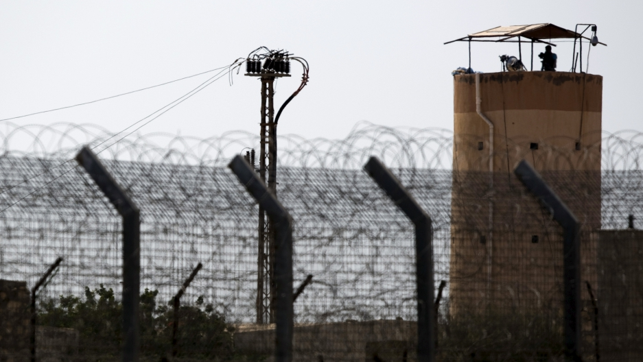 A member of Egypt's security forces stands on a watchtower in North Sinai as seen from across the border in southern Israel July 1, 2015. (Amir Cohen/Reuters)