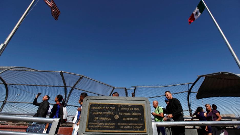 Cuban migrants cross the border into El Paso