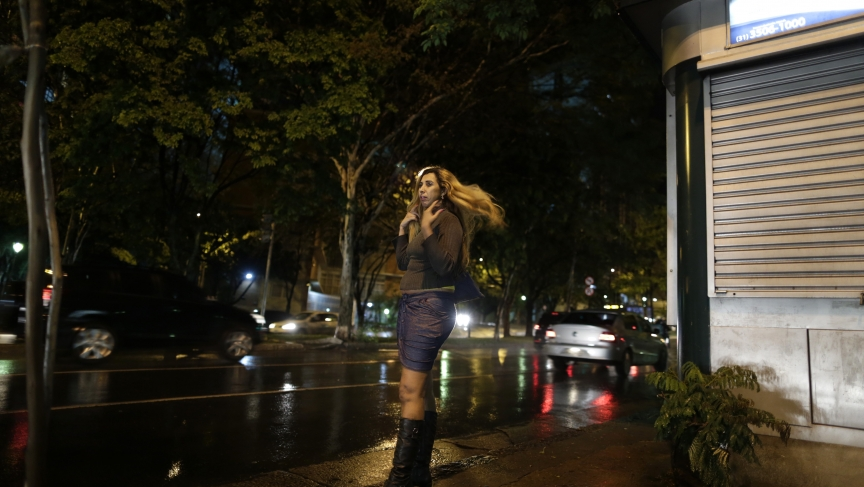 Cida Vieira, president of the Association of Prostitutes of Minas Gerais, looks for clients along a street in Belo Horizonte, November 5, 2013. A group of sex workers are taking English classes once a week in preparation for the World Cup.