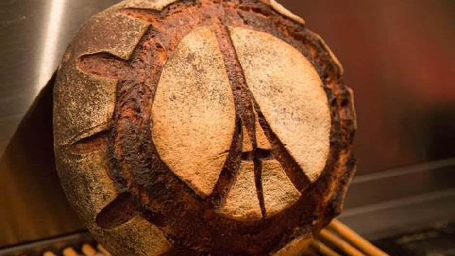 The iconic Eiffel Tower peace symbol on a loaf of French bread.