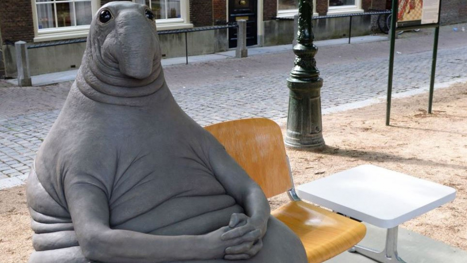 """Dutch artist Margriet van Breevoort  created the gray tubby creature, """"Homunculus Loxodontusa""""  nicknamed """"the one who waits."""""""