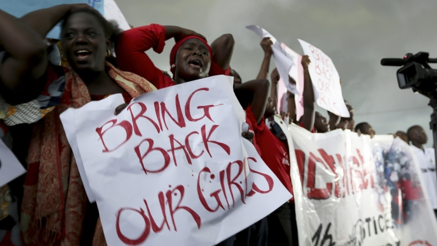 Women react during a protest demanding that Nigerian security forces search harder for 200 schoolgirls abducted by Islamist militants.