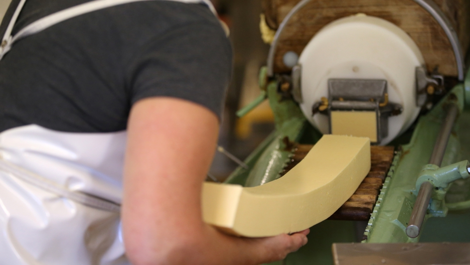 An employee prepares organic unpasteurized butter