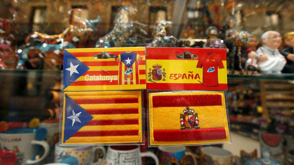 "Patches of ""Estelada"" (Catalan separatist flag) and Spain flags"