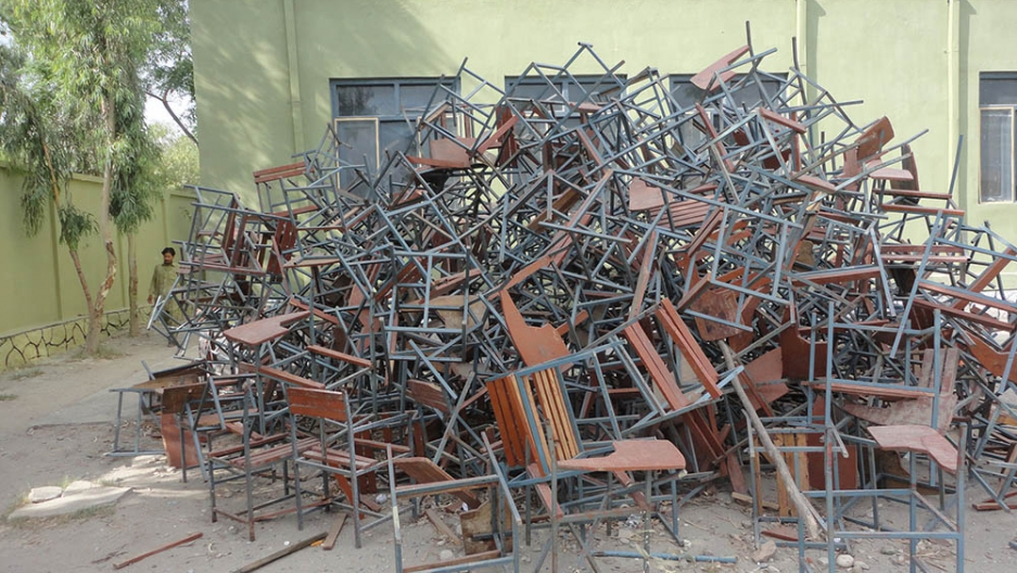 Chairs at a school built, but never occupied, were stripped for firewood.