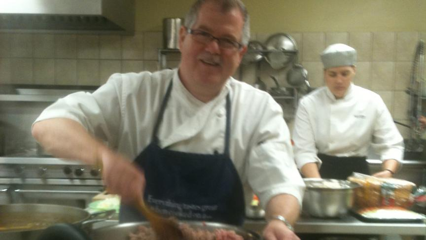 Chef Marc Miron busy in the kitchen at his Cuisine & Passion gourmet shop.