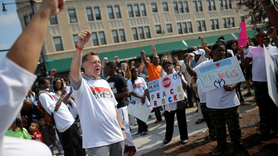 Father Michael Pfleger takes part in an anti-violence peace demonstration