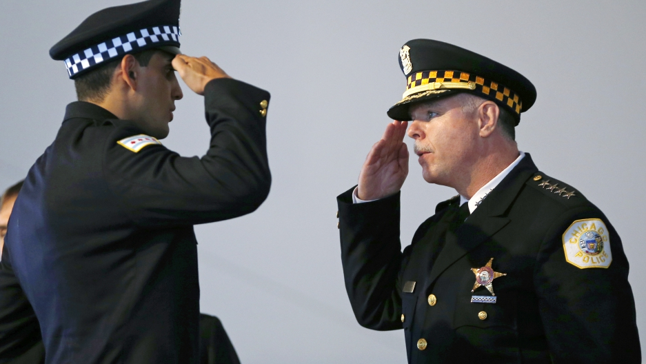 Chicago Police Superintendent Garry McCarthy (R) returns a salute to an unnamed recruit during a recruitment graduation ceremony in Chicago, Illinois on April 21, 2014. Chicago's police chief was ousted on December 1, 2015 following days of unrest over video footage showing the shooting of a black teenager and the filing of murder charges against a white police officer in the young man's death. (Jim Young/Reuters)