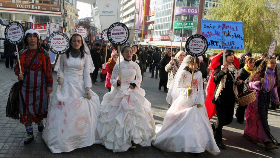 "Women activists, some dressed in wedding gowns representing child brides forced into marriage, hold placards that read ""End violence"" to protest rape and domestic violence, in Ankara, Turkey. November, 2011."