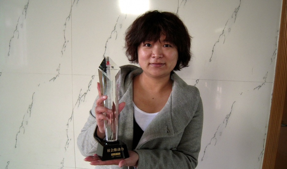 Women's rights activist Wu Rongrong poses with a trophy in this undated picture taken in an unknown location in China, provided by a women's rights group on April 8, 2015.