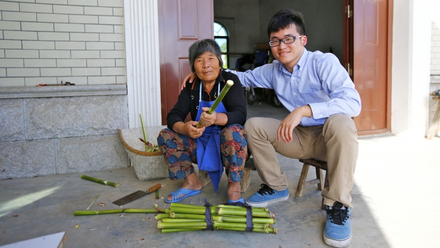 Gu Hangyu, sits with his grandmother Wang Yufang, at her home on Chongming Island near Shanghai. She speaks the Chongming dialect, but not standard Chinese.
