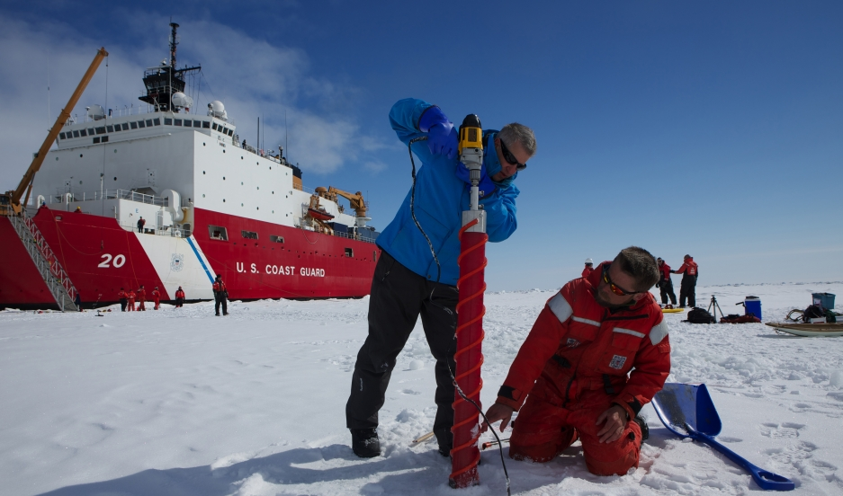 Ice scientists Ken Golden and Chris Polashenski drill a plastic tube into the Arctic ice cap north of Alaska as part of their research into melt ponds that form on the ice every spring. The ponds play a key role in the accellerated warming of the Arctic,