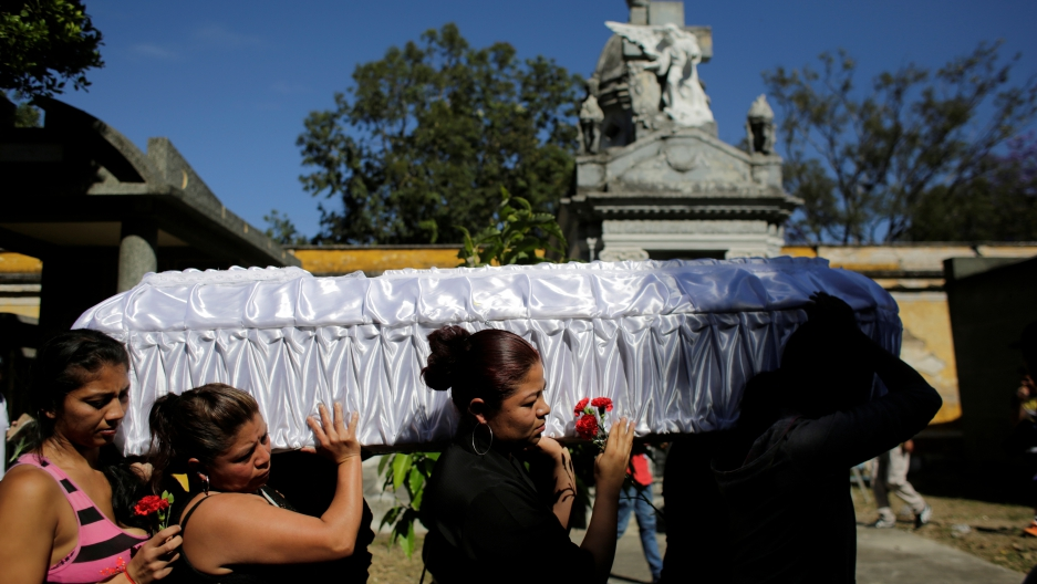 Relatives and friends carry the coffin of Kimberly Palencia