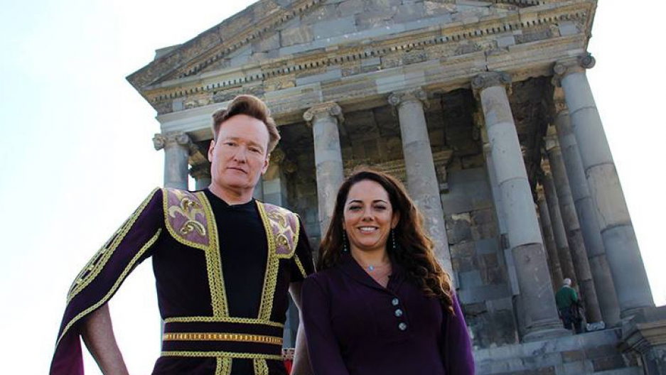 Late night comic Conan O'Brien in traditional folk dress and his TV assistant Sona Movsesian.