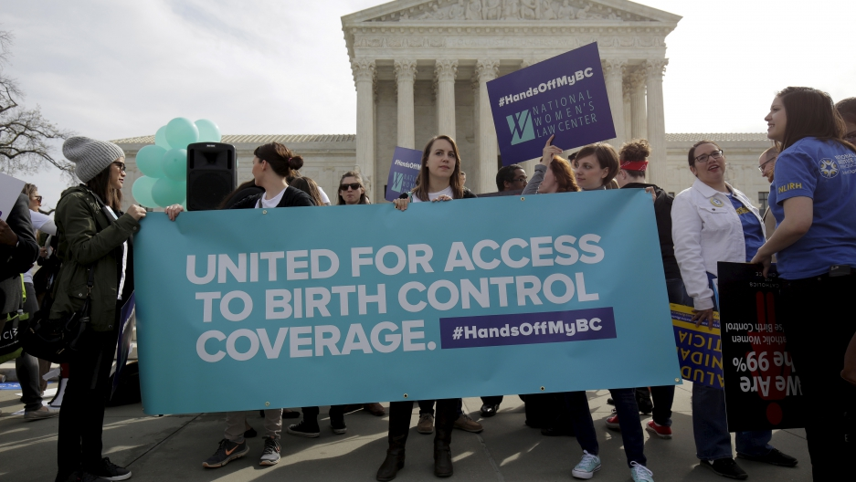 Supporters of contraception rally before Zubik v. Burwell is heard at the Supreme Court