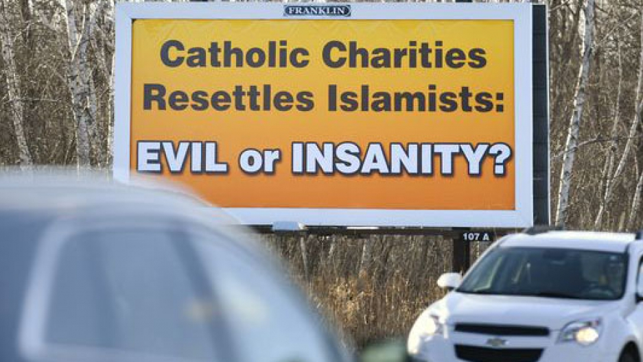 A billboard in Waite Park, Minnesota, near St. Cloud. The owner agreed to take it down because Catholic Charities does not resettle refuguees in the area.