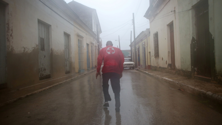 A member of the civil defense runs on the street